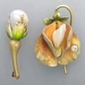Art nouveau enameled gold flower brooches sweet pea by bippart griscom  osborn centers irregular pearl 15 ct oec diamond dew drop rosebud with 125 mm x 95 mm river pearl and diamond accent