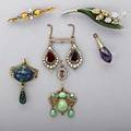 Gold antique jewelry and fragments eight items 18501950 austrian crystal jade lilyofthevalley brooch with diamonds foilbacked garnet elements with split pearl surrounds azurite pendant ame