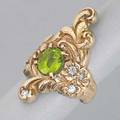 Art nouveau chased and jeweled gold ring ca 1900 scrolling tendrils with oval peridot and four oec diamond accents 14k yg 6 dwt 93 gs size 6