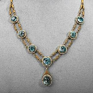 14k gold zircon and seed pearl necklace ca 1915 rows of wrapped wire links suspend circular and oval faceted blue zircons framed by strung seed pearls 195 dwt 305 gs 16 drops 1 12