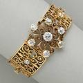 14k gold diamond scroll and panel bracelet circular scroll cluster and pierced panels with fourteen oec diamond principal stone approx 105 cts approx 485 cts tw 258 dwt 403 gs 6 34