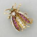 Jeweled 18k gold insect brooch mid 20th c diamond thorax and abdomen ruby wings with diamond trim emerald eyes diamonds approx 92 ct tw 93 dwt 144 gs 1 14
