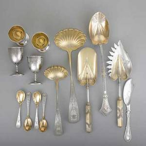 American ornate silver 18601880 fourteen pieces most parcelgilt retailed by bailey  co philadelphia gorham parcelgilt and bright cut neoclassical oyster server and ice cream shovel gorham