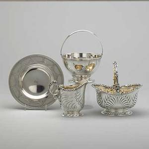 Tiffany  co silver holloware ca 18871912 cream and sugar service consisting of pitcher and swing handled bowl with shell and pearl decorations ca 1887 swing handled bowl ca 1909 shallow