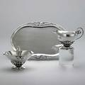 Georg jensen silver cream and sugar service denmark after 1945 three spothammered pieces cream pitcher and open fixedhandled sugar basket 235b with open tendril columns and buds on blossom
