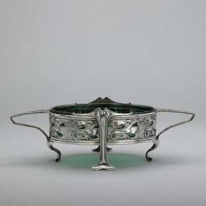 William hutton  sons silver center bowl art nouveau ovalshaped with loop handles and rolled or puddle feet with pierced and embossed oriental cloud and holly branches greenglass liner london 19