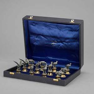 Silver hunt motif figural card holders miracoli italy cased set of twelve place card holders includes hounds wild boars and game birds on gilt plinths marked 925 and 6mi 2347 ot largest 2 58