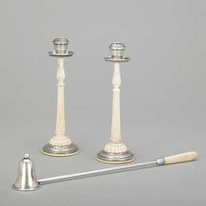 Sterling and ivory candlesticks and snuffer pair of delicate neoclassical candlesticks fluted with egg and dart ornament unmarked 7 american sterling snuffer with ivory handle 12 20th c int