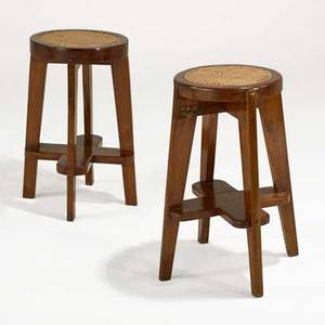 Pierre jeanneret pair of round high stools from the scientific block at chandigarh franceindia 1960s teak cane one has stenciled numbers 26 34 x 18 14 provenance chandigarh india liter