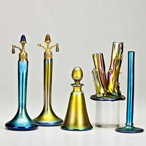 Steuben five aurene glass items corning ny three perfume bottles and two bud vases all signed tallest 10