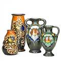 Zuidholland gouda four pieces two doublehandled vases in hollandia pattern 191819 and two vases in nadro pattern 192428 gouda netherlands all marked gouda holland with pattern name tall