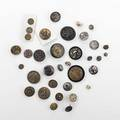 Asian button grouping approx eighty items include mixed metal satsuma ivory etc 19th20th c largest 1 14