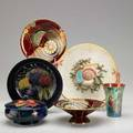 English pottery six items late 19thearly 20th c fielding twohandled tray moorcroft hibiscus covered jar and wisteria and pomegranate bowl pair of carltonware footed compotes and lustre cup wit