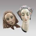 Lenci porcelain two masks 20th c both marked artist cartouche larger 14 x 9 x 5 12