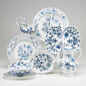Meissen blue onion seven items 19th20th c teapot sauce tureen gravy boat nappy reticulated round platter and 2 twosection serving dishes crossed swords mark teapot 9 34
