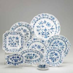 Meissen blue onion fiftyfive items 20th c 12 dinner plates 8 soup bowls 8 cake plates 8 demitasse cups and saucers 4 salad plates and 7 assorted serving pieces various marks di