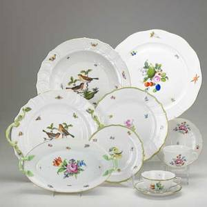 Herend porcelain thirty items 20th c 6 cups saucers dinner and cake plates in fruit pattern 4 cups and saucers in floral pattern oval vegetable dish and large cake plate with floral patter