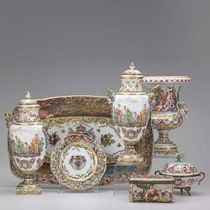 Capodimonte seven handpainted items 19th20th c armorial platter pair of covered urns footed handled trinket box rectangular trinket box armorial plate and open twohandled urn tallest 13 1