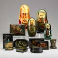 Palekh group twelve handdecorated lacquer items late 20th c three matryoshka political dolls and nine boxes all signed some in cyrillic tallest 11