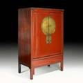 Asian red lacquer cabinet paneled doors with brass center medallion and chinoiserie decorated interior panels 20th c 70 12 x 46 x 26