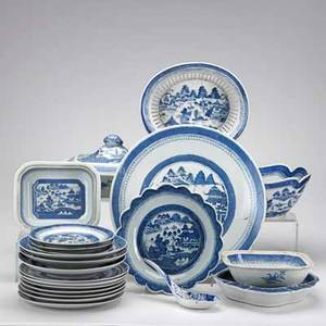 Blue and white canton china twentytwo pieces include 7 10 plates 3 9 34 shallow bowls 15 charger covered serving dish lotus form bowl etc 19th c