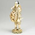 Japanese bone or ivory figure basket seller early 20th c 12 12