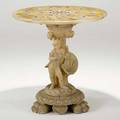 Alabaster center hall table figural base on paw feet and inlaid foliate design top 20th c 31 12 x 30 12 dia
