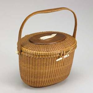 Jose formoso reyes nantucket basket covered woven basket with ivory pin swivels and carved ivory whale on lid 20th c marked made in nantucket jose formoso reyes 1960 7 12 x 10 12 x 7 12