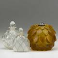 Lalique three bottles 20th c artichoke perfume burner in amber marquila bottle with blue patina and jaytho bottle with tulips all marked tallest 4