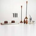 Arne jacobsenetc eleven pieces arne jacobsen stainless ashtray three silverplate dansk animals two pairs of salt and pepper shakers pair of candlesticks and dragsted cigarette box ashtray mar