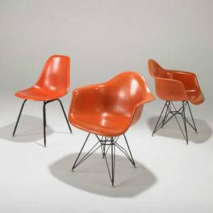 Charles and ray eames herman miller pair of armchairs on eiffel tower base dar and single side chair usa 1960s molded fiberglass enameled steel and rubber marked armchair 31 x 25 x 23