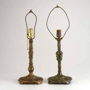 Oscar bach two patinated bronze table lamps with reticulated bases of birds and theatrical masks new york c1925 both marked taller to top of harp 23