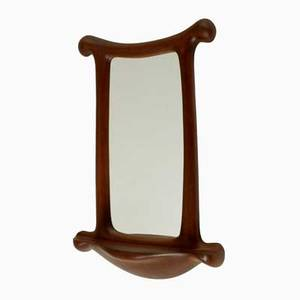 Wendell castle wallhanging mirror with integrated console rochester new york 1978 laminated and carved cherry mirrored glass incised wc 78 40 12 x 26 x 8 12 provenance commissioned fro