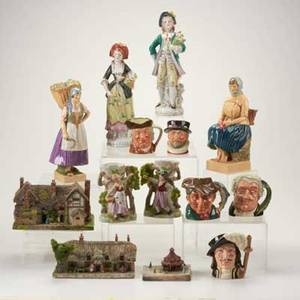 Figural pottery group fourteen pieces 20th century two dulwich figures five royal doulton toby mugs three glebe houses pair of japanese vases and pair of european style figures most marked ta