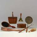 Shaker and shaker style eight implements pierced skimmer brush hand mirror fork scoop lidded box school bell and basket 19th20th c assorted woods brass iron mother of pearl horse hair