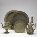 Pewter group six pieces two coffee pots two chargers dinner plate and caster 18th20th c some marked largest charger  16 14