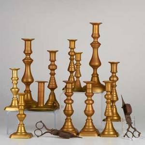 Brass candlesticks fourteen beehive and balustershaped candlesticks five pairs one single and one chamberstick together with two forged iron wick trimmers england and america 19th c some marke