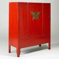 Red lacquer asian cabinet four door with brass butterfly center medallion 20th c 64 x 53 x 21