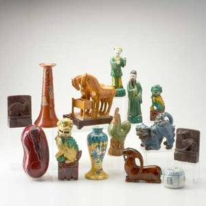 Asian decorative group fourteen pieces 19th20th c tang style two horse pottery figure two pottery foo dogs soapstone bookends etc tallest 10