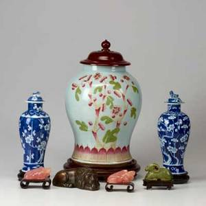 Asian decorative group seven pieces 19th20th c large lidded vessel with raised polychrome decoration pair of blue and white lidded jars three carved hardstone figures and a bronze lion blue an