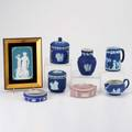 Wedgwood mettlach eight pieces 20th c four jasperware lidded boxes two creamers and vase together with mettlach cameo plaque all marked plaque overall 8 x 6
