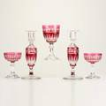 Cranberry glass approximately twentyseven cut glass pieces eleven water goblets fourteen sherbets and pair of candlesticks probably bohemian unmarked goblets 6 58