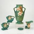 Roseville green magnolia five pieces tall handled vase two teapotshaped vases cornucopia vase and underplate raised marks tallest 15 12
