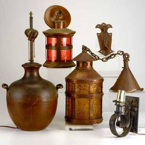 Arts  crafts lighting etc five pieces two copper and glass lanterns handled copper table lamp wrought iron sconce and door knocker all unmarked largest lantern15 x 8