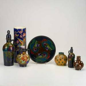 Gouda rozenburg etc seven pieces gouda drink set and handled vase rozenburg cabinet vase longwy enameled vase and stoneware vase with yellow ground all marked tallest 12 12