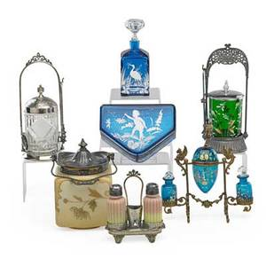 American victorian glass seven items late 19th c two pickle castors mary gregory bottle and dresser box peachblow salt and pepper cracker jar and enameled blue glass condiment set tallest 10