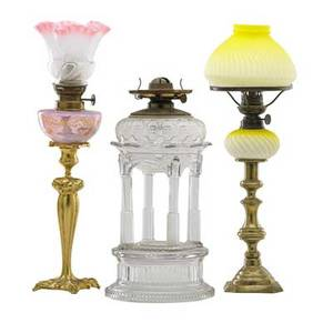 American victorian oil lamps three late 19th c two peg lamps with shades and brass bases and tomb lamp with columnar base tallest 18 12