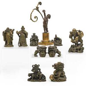 Asian bronze items ten 20th c nine figurines in various sizes and a cherub on a pedestal cherub 8 12