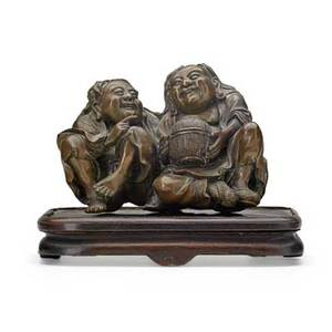 Japanese bronze okimono two seated figures on a wood pedestal early 20th c 3 x 4 x 2 12