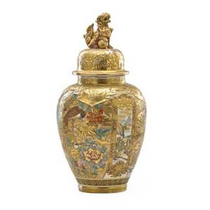 Japanese satsuma covered urn heavily decorated with gilt floral and bird decoration the lid with buddhist lion finial early 20th c 24